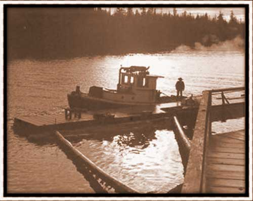 John Boom on tug boat at Bamfield dock.